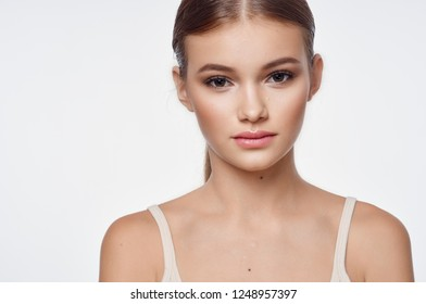 Pretty woman with blond hair on a white background