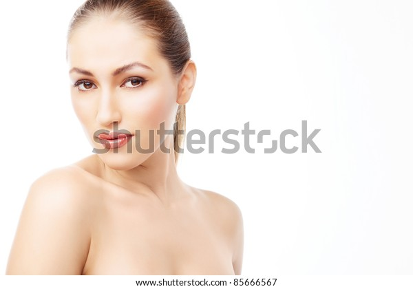 Pretty woman with brown hair and beauty lips looking to camera, isolated on white background