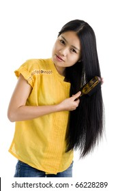 pretty woman brushing her long hair, isolated on white background