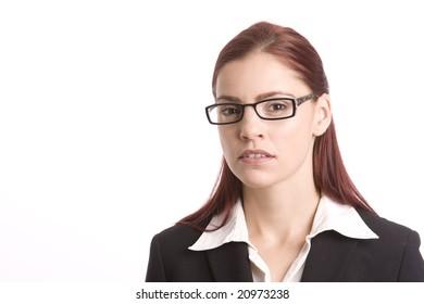 Pretty woman in business attire wearing glasses