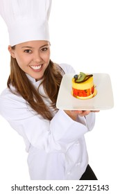 A pretty woman chef holding a dessert isolated over white