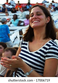 Pretty woman clapping at event
