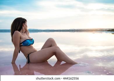 Pretty woman in a colorful lake