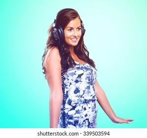 pretty woman dancing with headphones