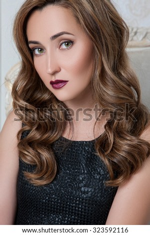 Pretty Woman with dark hair and green eyes. makeup. girl with perfect skin