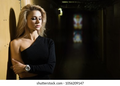 A pretty woman in a dark room. Noir film concept