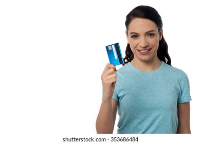 Pretty woman displaying her credit card over white