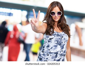 pretty woman doing a victory sign