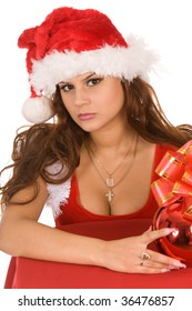 pretty woman dressed as Santa Claus with sack of presents