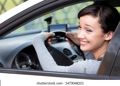 Pretty woman driver happily laughing in a car, closeup shot