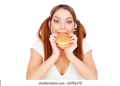 pretty woman eating burger with gusto. isolated on white