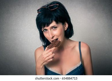 Pretty woman eating chocolate