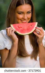 Pretty woman eating water-melon outdoor