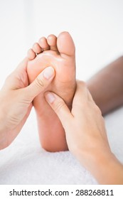Pretty woman enjoying a foot massage at the health spa