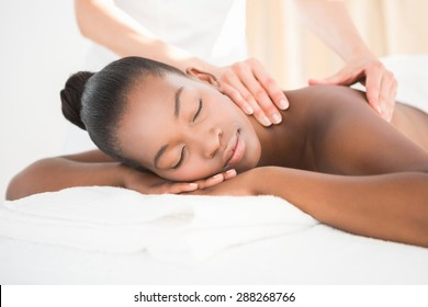 Pretty woman enjoying a massage at the health spa