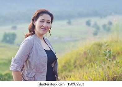Pretty woman enjoying nature