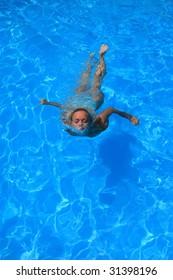 Pretty woman enjoying a swimming pool in Greece