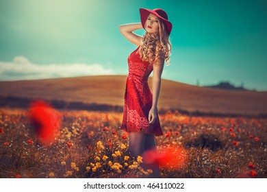 pretty woman in the field of poppies