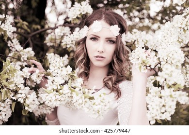 Pretty woman flower hair band front stock photo royalty free pretty woman with flower hair band in front of a blossoming apple tree woman in mightylinksfo