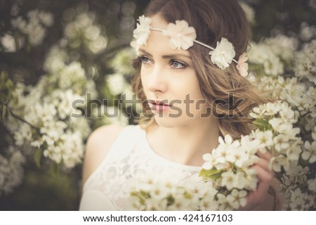 Pretty woman flower hair band front stock photo edit now 424167103 pretty woman with flower hair band in front of a blossoming apple tree spring mightylinksfo