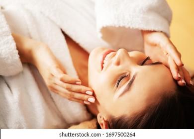 Pretty woman getting spa treatments at beauty studio.