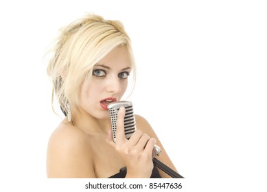 Pretty woman or girl music singer with microphone isolated on white
