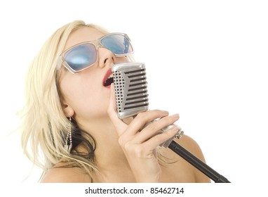 Pretty woman or girl music singer with microphone and sunglasses on white