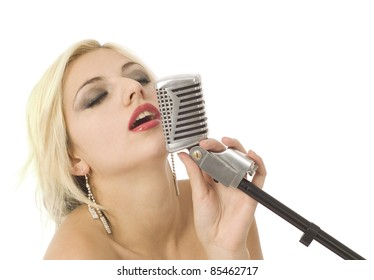 Pretty woman or girl music singer with microphone on white