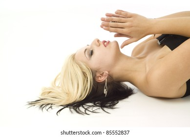 Pretty woman or girl music singer with hands praying around microphone