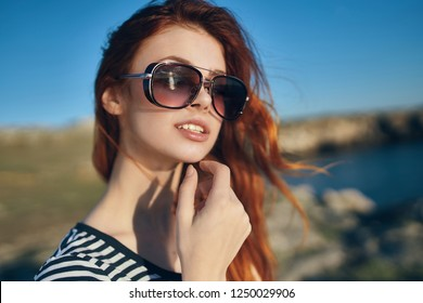 Pretty woman with glasses on nature