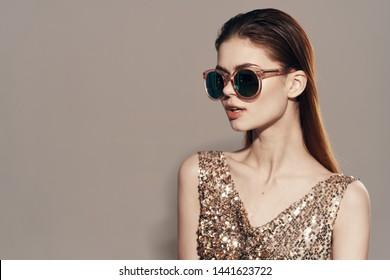 Pretty woman golden dress dark glasses lipstick lifestyle luxury smile