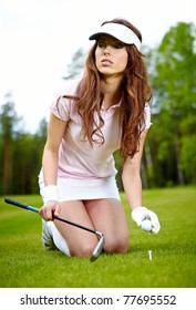 A pretty woman golfer