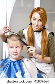 Pretty woman hairdresser cuts client