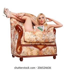 The pretty woman has relaxed on a sofa. White background.