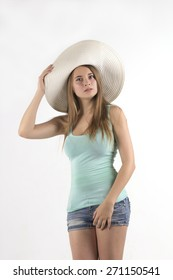 pretty woman in hat over white background