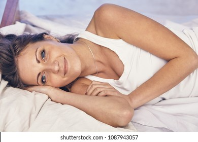 Pretty woman have fine on her bedroom. Young lady enjoying her morning and wake up.