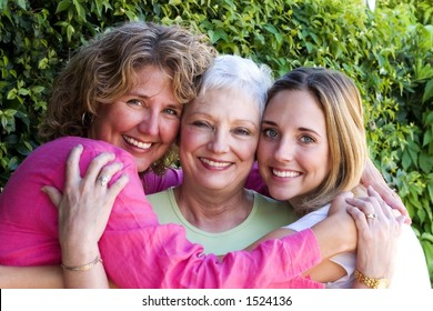 pretty woman with her beautiful mother and daughter.