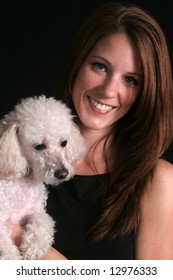 Pretty woman with her poodle dog