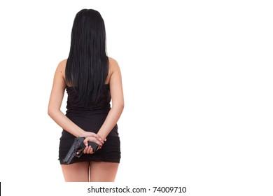 Pretty woman is hiding a handgun behind her back