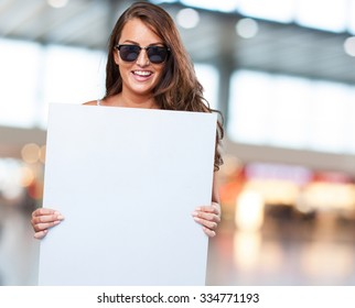 pretty woman holding a banner