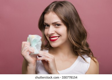 Pretty woman holding a bottle of lotion and a bubble maker