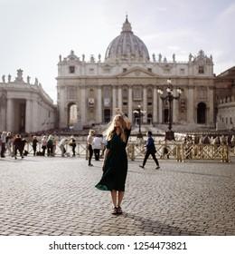Pretty woman int he Rome near symbol of Vatican. Saint Peter church in Vatican