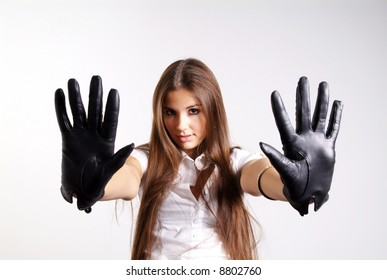 pretty woman with long hair and black leather glove