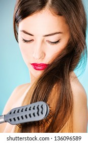 Pretty woman with long hair and comb