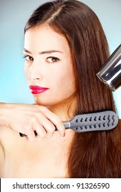 pretty woman with long hair holding blow dryer and comb