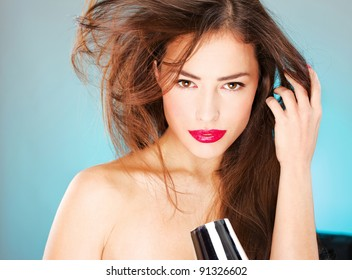 pretty woman with long hair holding blow dryer