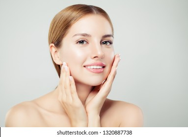 Pretty woman looking at camera. Beautiful face with healthy clear skin, natural makeup and natural eyebrows portrait on white background