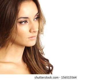 Pretty woman looking to her left on white background