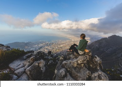 Pretty woman looking over the harbour from Table Mountain in Cape Town