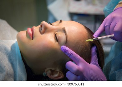 Pretty woman makes botox injections for beauty effect